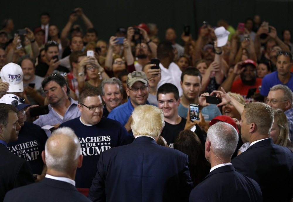 Republican presidential candidate Donald Trump, center, greets attendees after speaking at a rally at Ohio University Eastern Campus in St. Clairsville, Ohio.