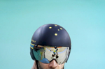 A teammate is reflected in the helmet visor of a member of the Australian men's cycling team during a training session inside the Rio Olympic Velodrome in advance of the 2016 Olympic Games in Rio de Janeiro, Brazil.