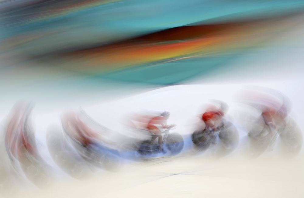 Members of the Chinese women's track cycling team round a turn during a training session inside the Rio Olympic Velodrome in advance of the 2016 Olympic Games.