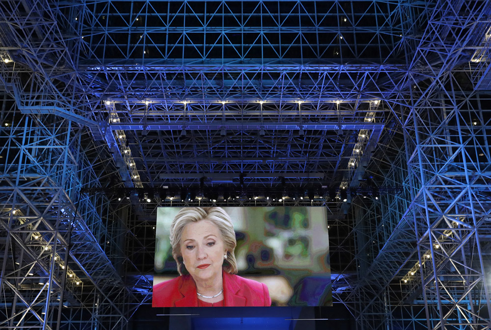 An advertisement for Democratic presidential nominee Hillary Clinton appears on a large display beneath the Jacob Javits Convention Center's glass ceiling as Clinton supporters gather and await results on Election Night in New York.