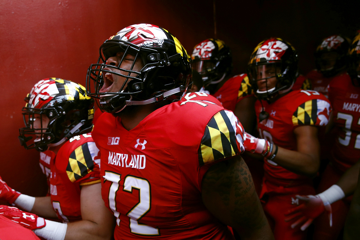 Maryland offensive lineman Marcus Minor screams as he walks in a tunnel to the field before a college football game against Texas in Landover, Md.