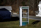 A phone booth stands on the side of a road in Head Waters, Va., inside the National Radio Quiet Zone. While pay phones have all but disappeared in the United States, they still can be found in this part of the country, where a cell phone signal is hard to come by. The quiet zone, which has been in place since 1958, aims to protect sensitive telescopes at the National Radio Astronomy Observatory, as well as a nearby Naval research facility, from interference created by cell phones and other everyday devices that emit electromagnetic waves.