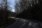 Sunlight peaks through trees as a car winds down a mountain road in Highland County, Va., inside the National Radio Quiet Zone. At 13,000 square-miles in size, the quiet zone is larger than the state of Maryland.