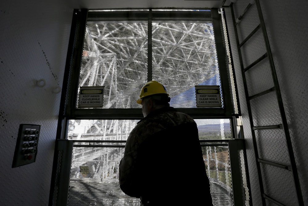 Michael Holstine, business manager at the National Radio Astronomy Observatory, closes an elevator door on the Robert C. Byrd Green Bank Telescope.