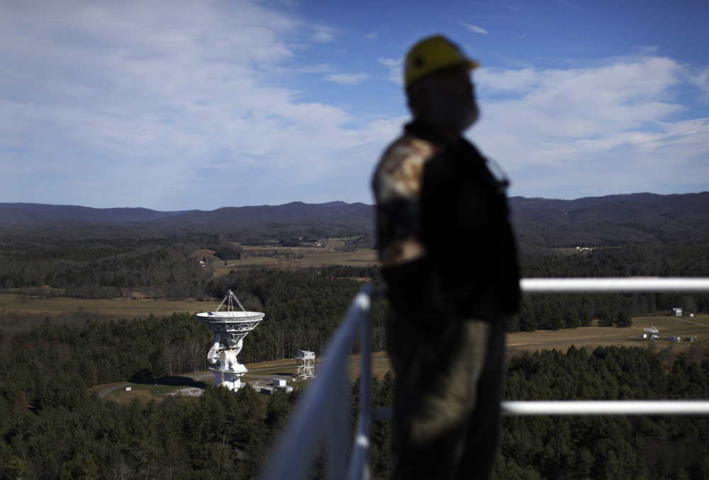 Michael Holstine, business manager at the National Radio Astronomy Observatory, stands on a platform atop the Robert C. Byrd Green Bank Telescope. Observatory employees regularly patrol a 10-mile radius surrounding the facility to mitigate electromagnetic interference emitted by everyday items like cordless phones, wireless routers, microwave ovens and even electric blankets.