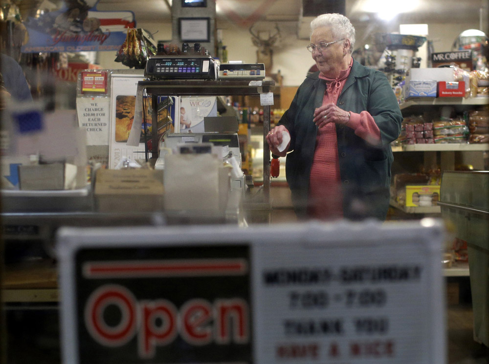 Betty Mullenax walks behind a checkout stand at Trent's General Store in Arbovale, W.Va., inside the quiet zone. {quote}We've never known any other way,{quote} she said of life without cell phones.
