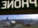 A passing truck is seen through the window of a phone booth in Head Waters, Va., inside the National Radio Quiet Zone. A 2013 Pew Internet poll reported that 91% of Americans have a cell phone. The National Radio Quiet Zone, where pay phones are easier to find than a cell phone signal, may be the last holdout in the continued growth of wireless technology.