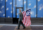 Lou Pumphrey of Veterans for Peace carries a flag in Cleveland the day before the start of the 2016 Republican National Convention.