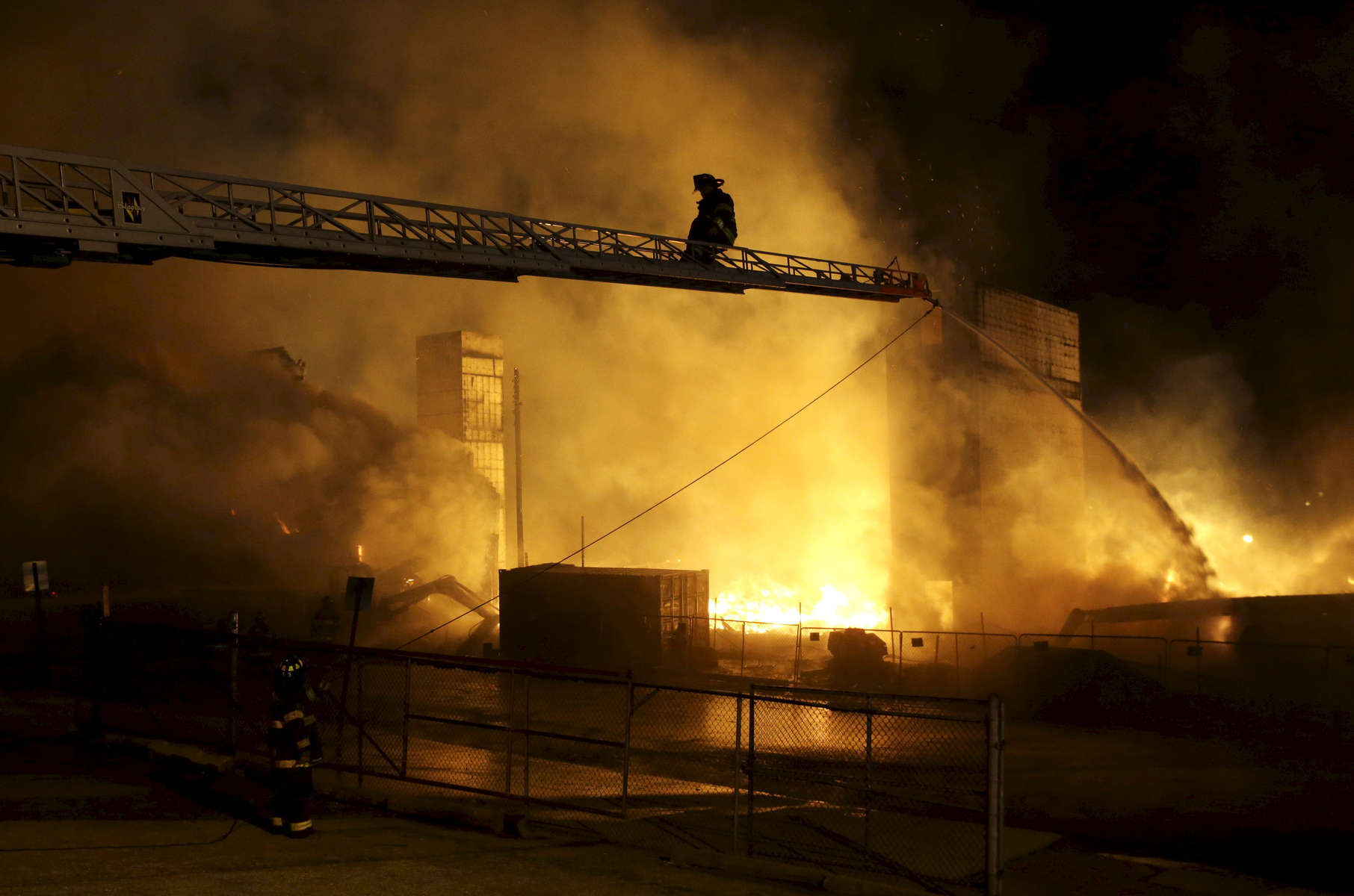 Firefighters battle a blaze as unrest continues into the night on the day of Freddie Gray's funeral.