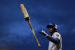 Kansas City Royals' Alcides Escobar flips his bat in the air as he prepares for an at-bat against the Baltimore Orioles.