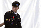 Army Pfc. Bradley Manning is escorted into a courthouse in Fort Meade, Md., on the third day of his court martial. Manning faced charges of indirectly aiding the enemy by sending troves of classified material to WikiLeaks.