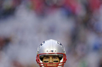 New England Patriots quarterback Tom Brady warms up before Super Bowl XLIX in Glendale, Ariz.