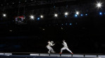 South Korea's Oh Ha-na and France's Astrid Guyart compete during a bronze medal match at women's team foil fencing at the 2012 Summer Olympics in London.