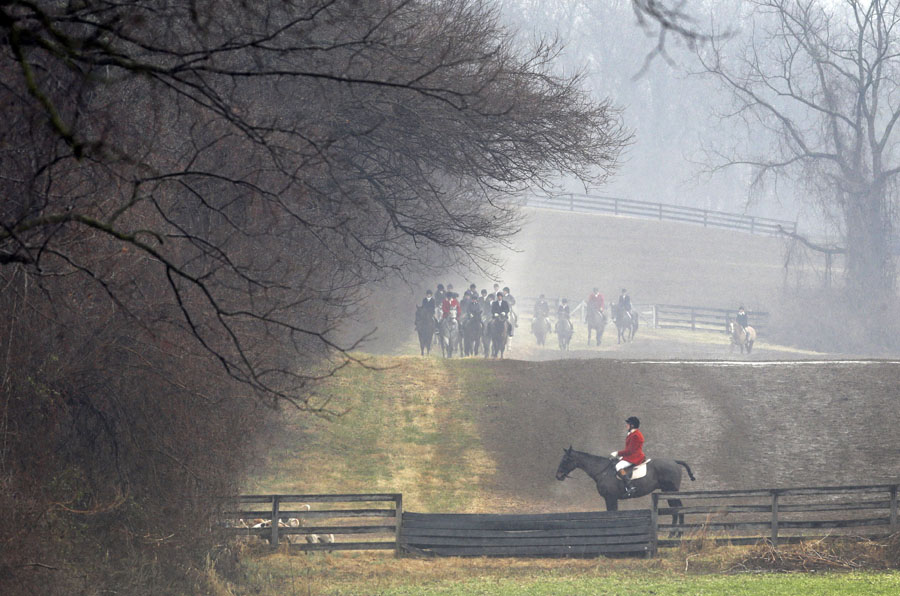 Members of the Elkridge-Harford Hunt Club follow a path during a fox hunt in Monkton, Md. In the midst of the heavily populated Boston-Washington corridor, the club has made efforts to preserve large swaths of open land from suburban development, hoping to uphold the club's nearly 140-year history and traditions with it.