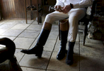 A member of the Elkridge-Harford Hunt Club who asked that he only be identified as Jed puts on his boots as he prepares for a fox hunt in Monkton, Md.