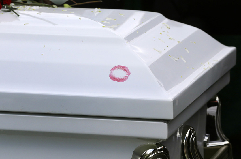 Lipstick marks Freddie Gray's casket at his burial at Woodlawn Cemetery in Baltimore.