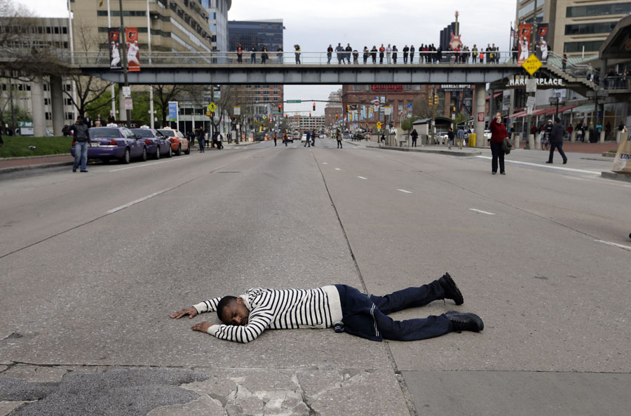 A protestor lays in the middle of a street during a march for Freddie Gray in downtown Baltimore.
