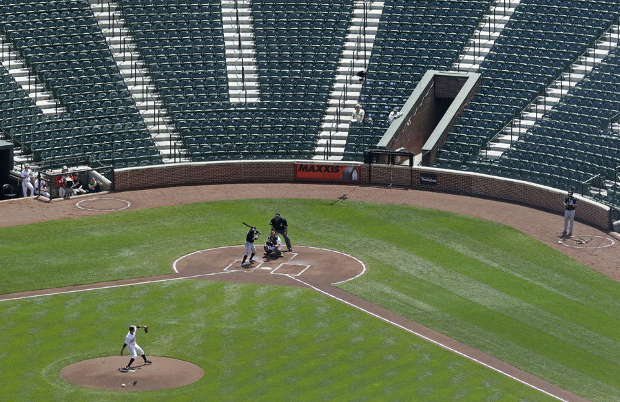 Baltimore Orioles starting pitcher Ubaldo Jimenez throws to Chicago White Sox's Adam Eaton during a baseball game in Baltimore. The game was played in an empty ballpark amid the unrest that followed Freddie Gray's death.