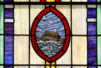 "A stained glass window depicts Noah's Ark inside the United Methodist Church in the community of Ewell on Smith Island, Md. ""We'll solve the national debt somehow,"" Rev. Rick Edmund said. ""And we'll take care of the shortfall in social security and a lot of other problems. But the impact of climate change is going to be felt for centuries."""
