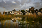 Homes sit alongside marshland in the community of Ewell on Smith Island, Md. The island's population, which has dwindled to a few hundred and is largely dependent on commercial fishing, is threatened by a combination of sea level rise and erosion.