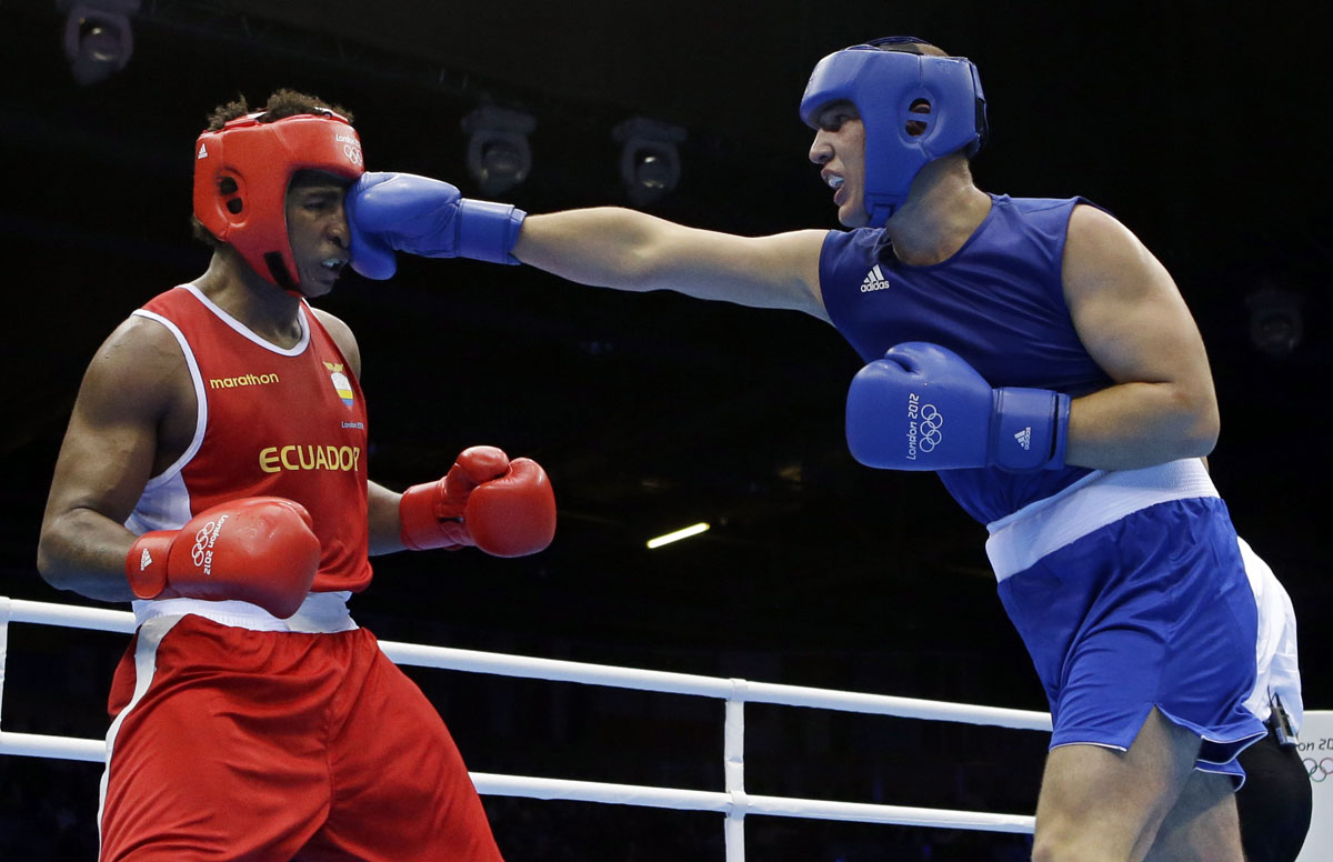 Ecuador's Julio Castillo Torres, left, fights Belarus' Siarhei Karneyeu during a heavyweight 91-kg boxing match at the 2012 Summer Olympics in London.