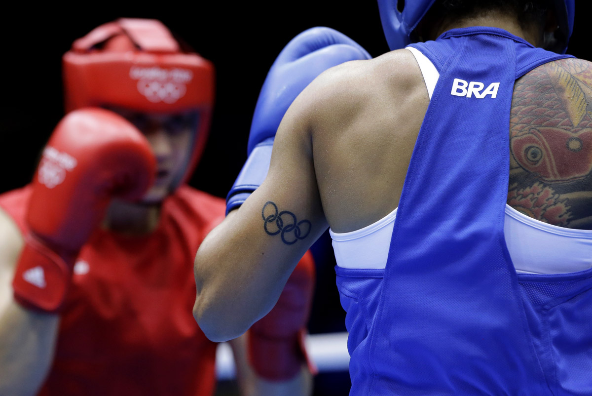 Brazil's Adriana Araujo, right, fights Morocco's Mahjouba Oubtil in a women's lightweight 60-kg boxing match at the 2012 Summer Olympics in London.