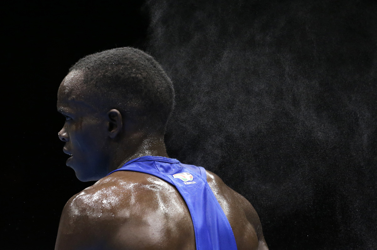 Mist floats off of Kenya's Benson Njangiru after his fight against Egypt's Hesham Abdelaal in a flyweight 52-kg boxing match at the 2012 Summer Olympics in London.