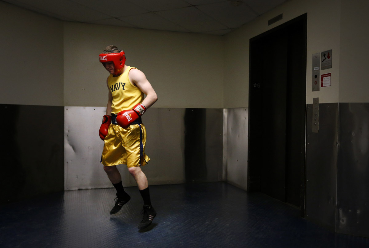 U.S. Naval Academy midshipman Ben Matson warms up in a hallway before his bout in the Brigade Boxing Championships in Annapolis, Md. The academy has offered boxing since 1865, both as a club sport as well as a required part of the physical education program.