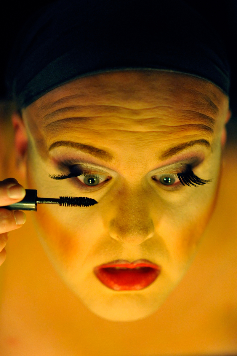 Sasha Stephens applies eye makeup while preparing to perform during the Gender Fuzions Cabaret in Monroe, Ga., Friday, Jan. 10, 2014. (AJ Reynolds/Staff, @ajreynoldsphoto)