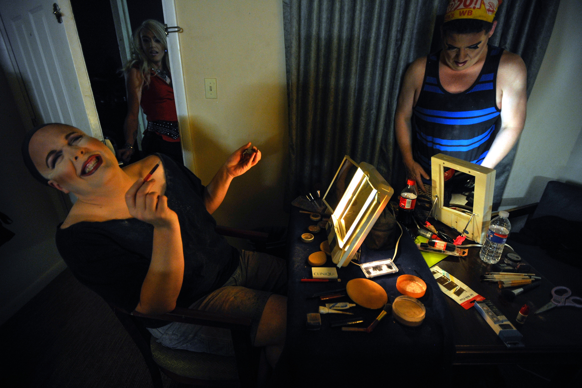 Sasha Stephens, left, laughs while Porsha Daniels speaks through an open door and Lacie Bruce works on getting ready inside a motel room in Monroe, Ga., Friday, Jan. 10, 2014. (AJ Reynolds/Athens Banner-Herald)