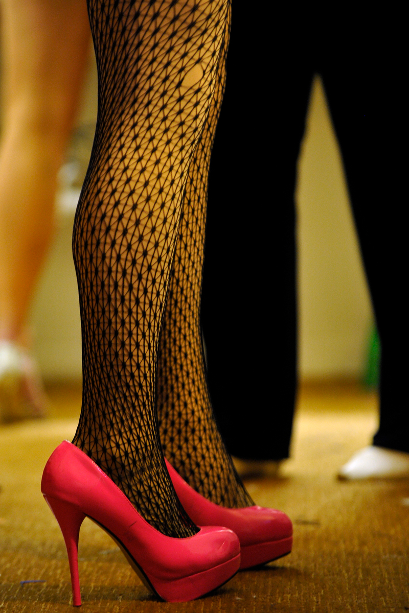 Lacie Bruce wears high heels inside a motel room while getting ready to perform during the Gender Fuzions Cabaret show in Monroe, Ga., Friday, Jan. 10, 2014. (AJ Reynolds/Staff, @ajreynoldsphoto)