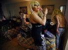 Heathe Daniels, second from right, uses hairspray while getting ready for the Gender Fuzions Cabaret show inside a motel room in Monroe, Ga., Friday, Jan. 10, 2014. (AJ Reynolds/Staff, @ajreynoldsphoto)