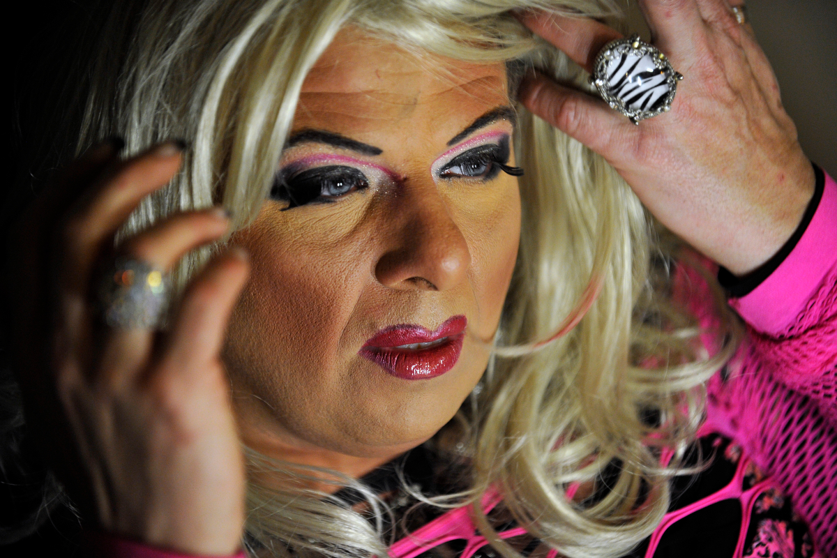 Lacie Bruce looks in the mirror and adjusts a wig while preparing to perform during the Gender Fuzions Cabaret in Monroe, Ga., Friday, Jan. 10, 2014. (AJ Reynolds/Staff, @ajreynoldsphoto)