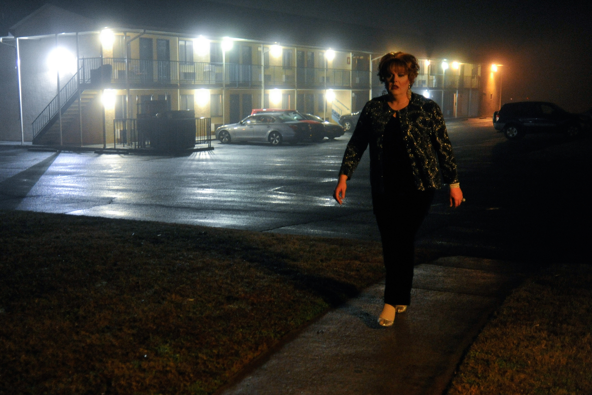 Sasha Stephens walks from the Deer Acres Inn toward Fuzions Bar & Grill for the beginning of the Gender Fuzions Cabaret show in Monroe, Ga., Friday, Jan. 10, 2014. (AJ Reynolds/Staff, @ajreynoldsphoto)