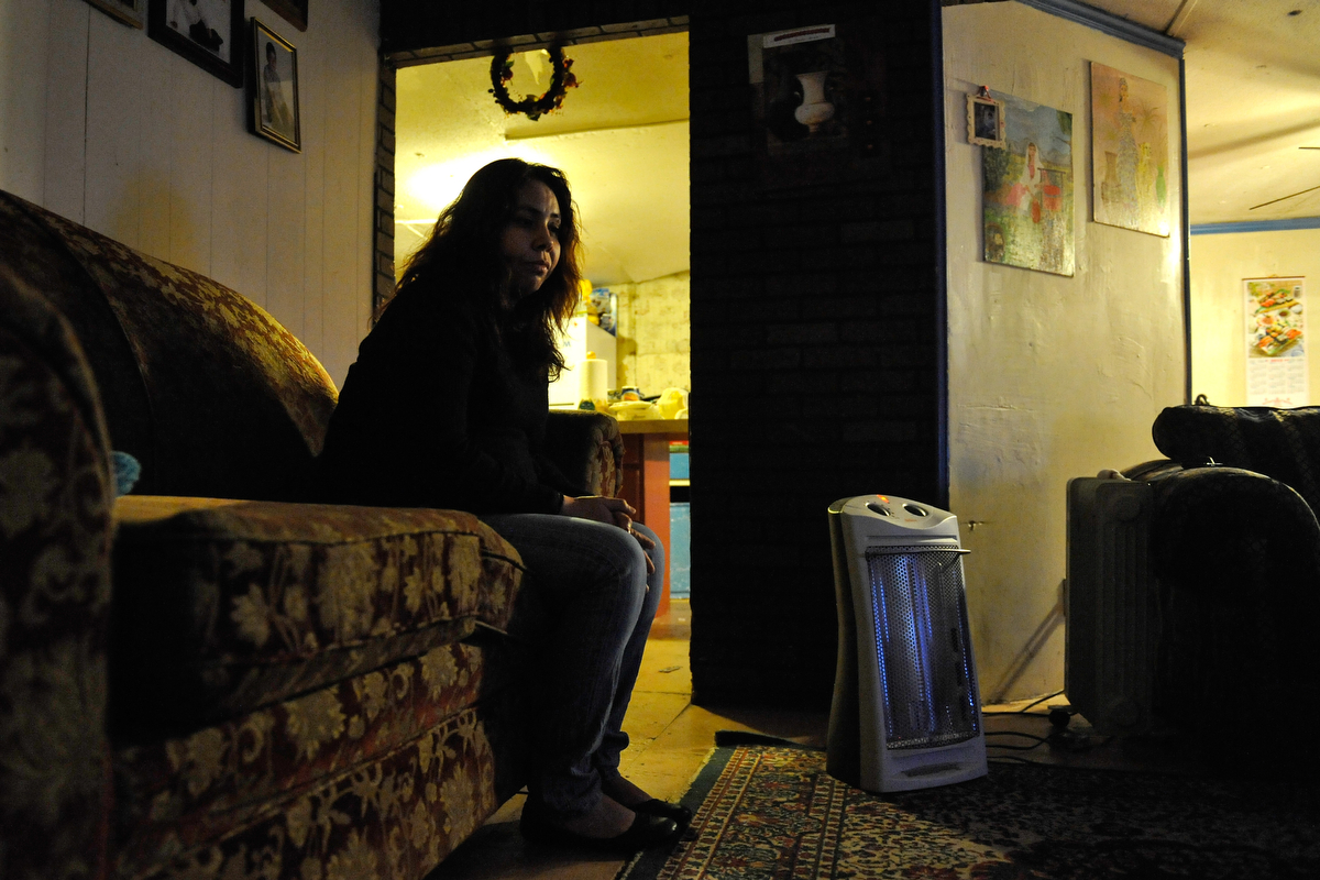 Sandra Juarez sits on a couch inside her home in Athens, Ga., Monday, Feb. 4, 2013. (AJ Reynolds/The Athens Banner-Herald)