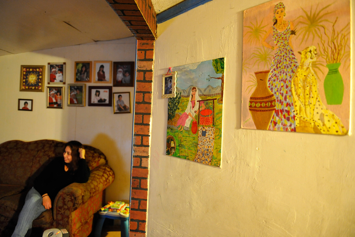 Two paintings by Jose Arreola hang inside Sandra Juarez's home in Athens, Ga., Monday, Feb. 4, 2013. Arreloa was deported to his home province of Torreon, Mexico on June 15, 2011. (AJ Reynolds/The Athens Banner-Herald)