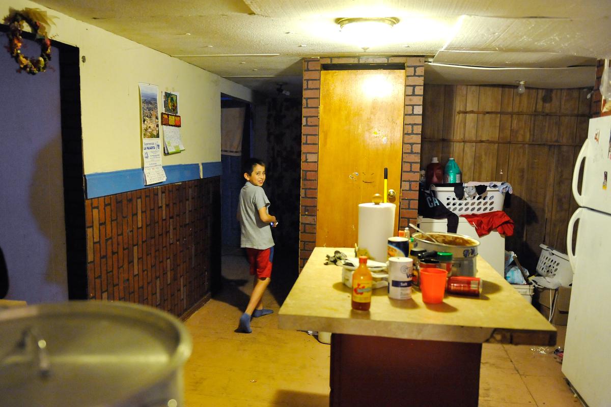 One of Sandra Juarez's children walks through their kitchen in Athens, Ga., Monday, Feb. 4, 2013. (AJ Reynolds/The Athens Banner-Herald)