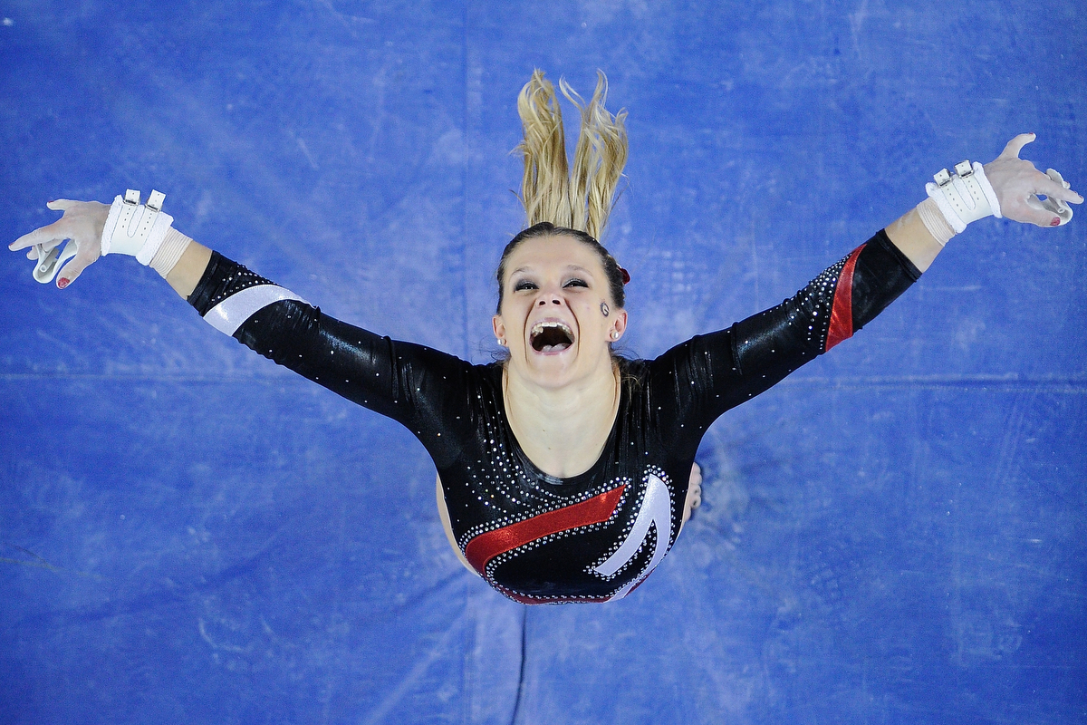 Georgia Gym Dog Brandie Jay reacts after dismounting from the uneven bars during an NCAA gymnastics meet between Georgia and LSU on Saturday, Feb. 13, 2016, in Athens, Ga. Jay scored a 9.925 on the event. (AJ Reynolds/Staff, @ajreynoldsphoto)