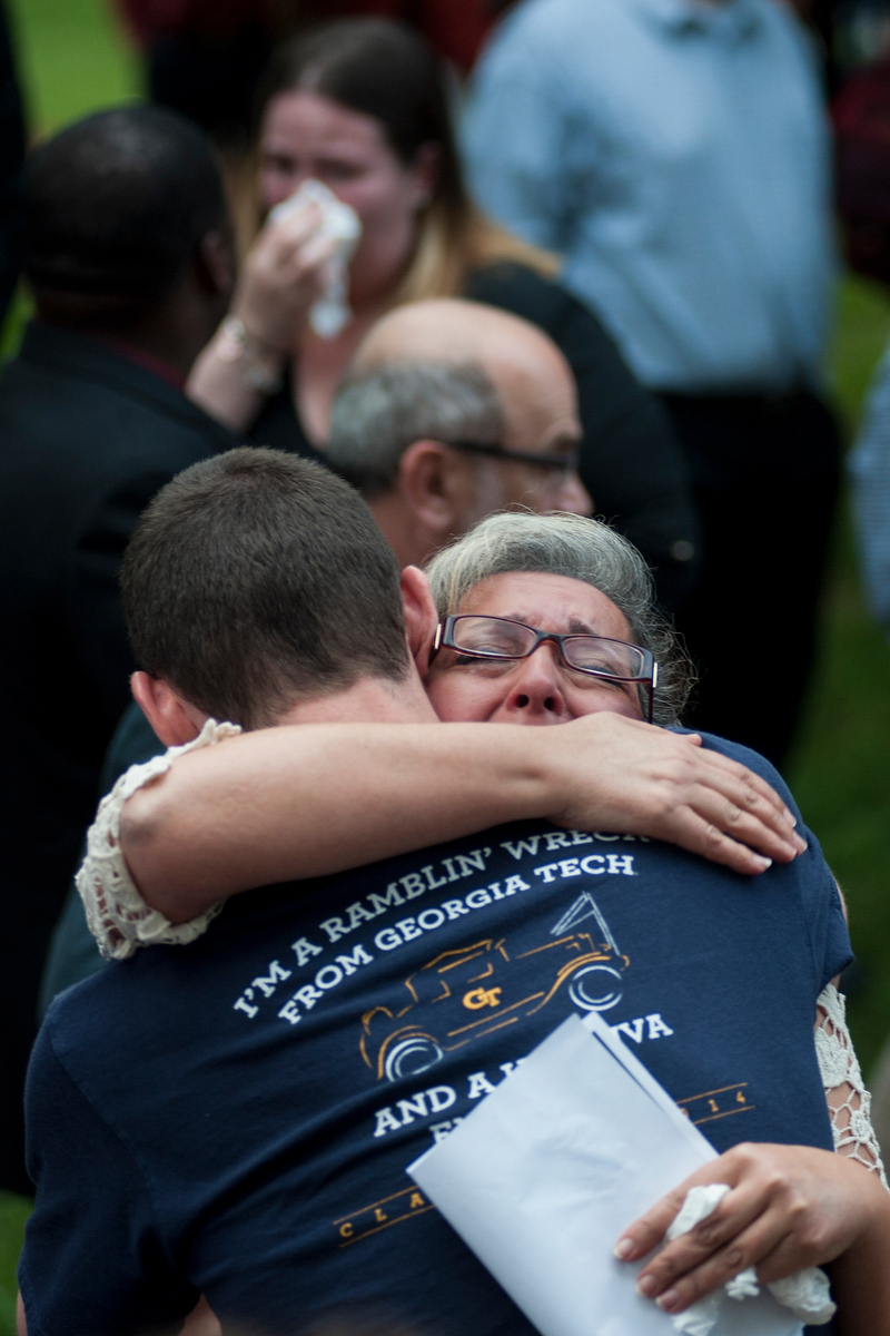Farideh Pedrami, mother to Sina Shayegan, gives a hug during the Georgia Remembers campus memorial at the University of Georgia on Tuesday, April 28, 2015. Shayegan was a biology graduate and doctoral candidate in the veterinary medicine program at the University of Georgia. (AJ Reynolds/Staff)