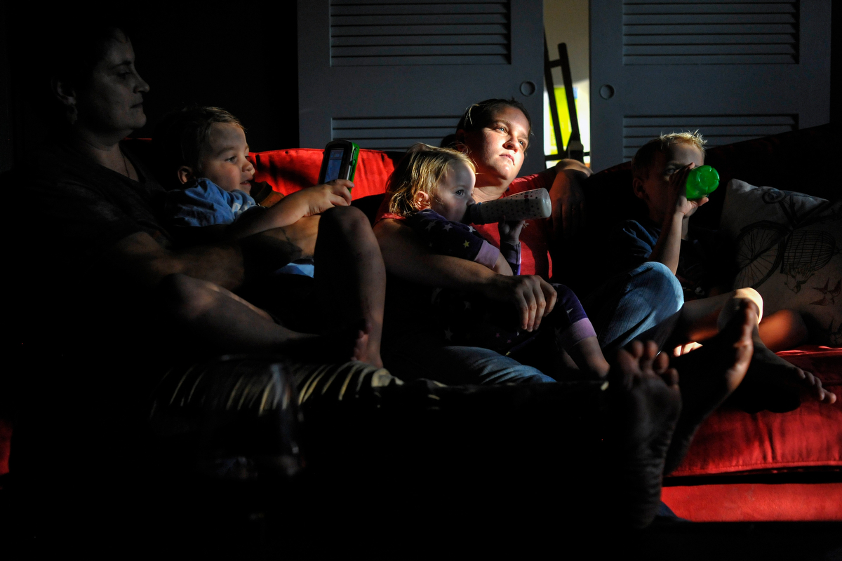 Heidi Hensely-Williams, left, and Rachel Hensley Williams watch television with their three children Baylor, from left, Opal and Zeke. Rachel Hensley-Williams works as a district attorney, so the couple are not elegible for partner benefits, even after the repeal of the Defense of Marriage Act. (AJ Reynolds/Athens Banner-Herald)