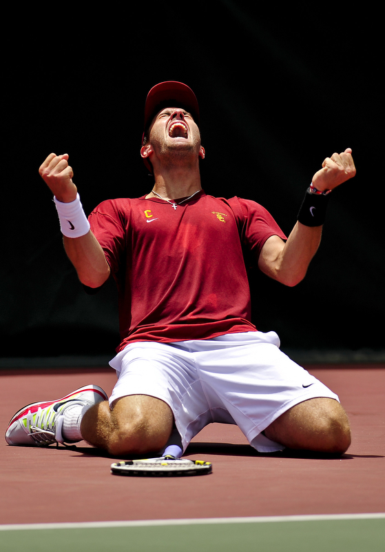 USC's Steve Johnson screams in celebration after winning the NCAA tennis championship singles finals in Athens, Ga., Monday, May 28, 2012. Johnson defeated Kentucky's Eric Quigley in straights sets to make it 72 consecutive singles wins. (AJ Reynolds/The Athens Banner-Herald)