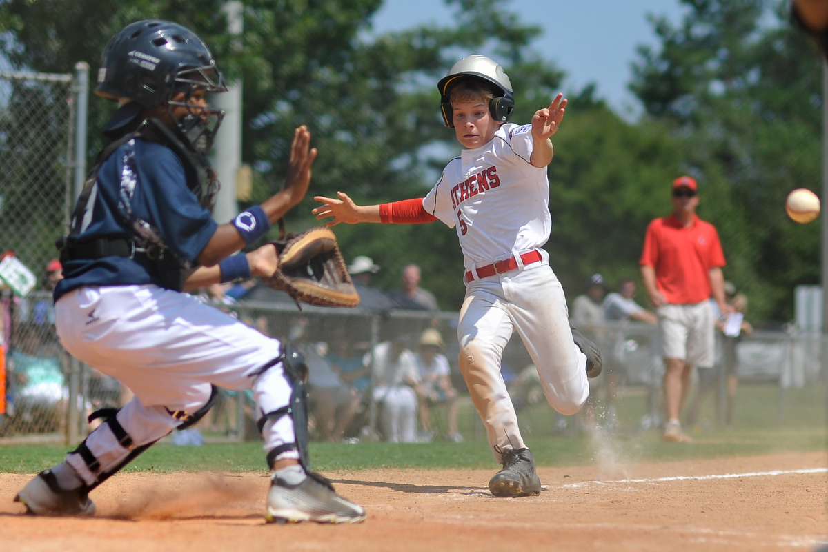 Athens Hamilton Culpepper slides into the plate during the Little League State Tournament on Saturday July 25, 2015, in Athens, Ga. Culpepper was called back for leaving third base too early, but scored later in the inning. (AJ Reynolds/Staff, @ajreynoldsphoto)