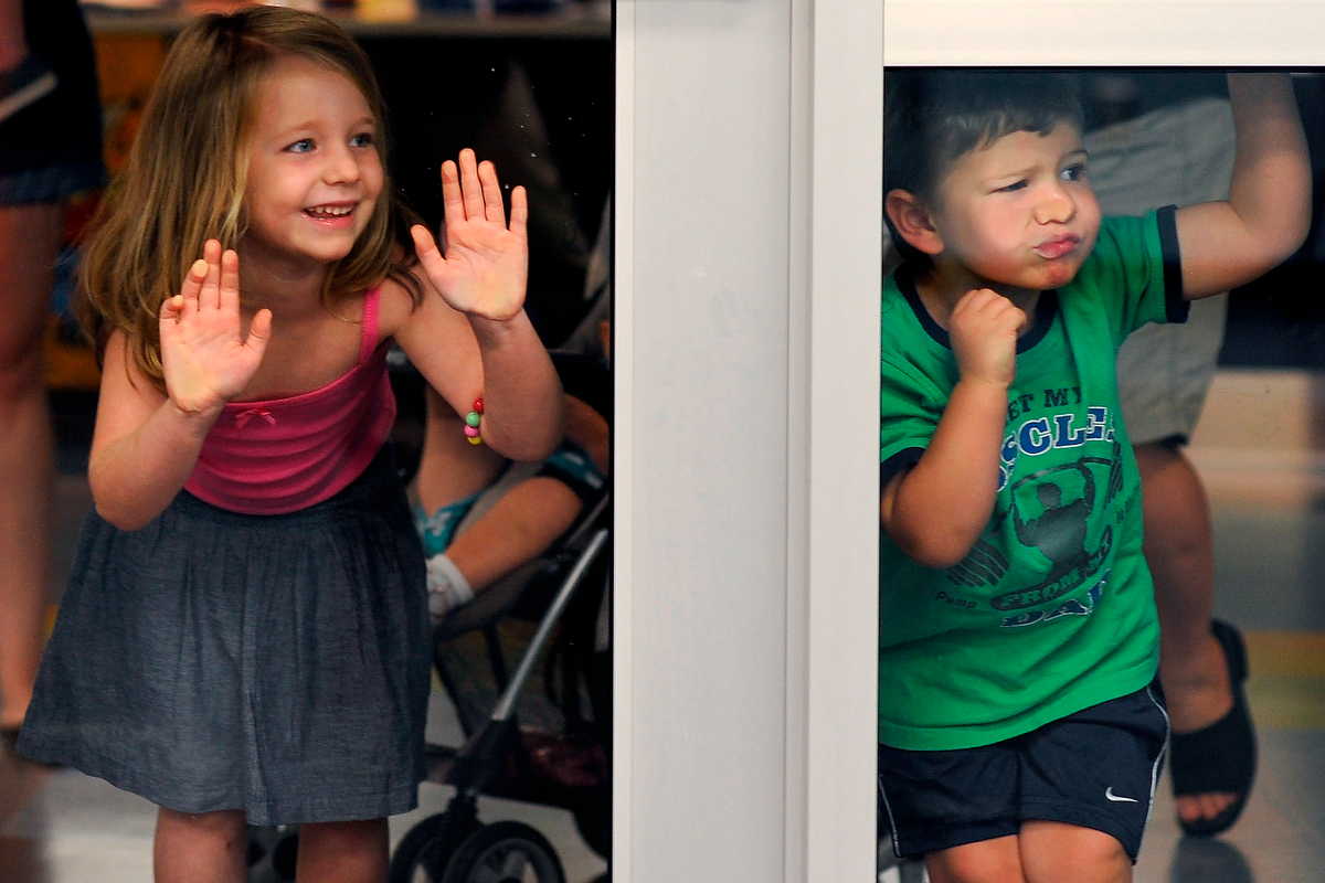 Kayden Gallagher, left, and Leland Bailey press up against the door while waiting for Baby Music Jam to begin at the Athens Regional Library in Athens, Ga., Monday, July 29, 2013. (AJ Reynolds/Staff)