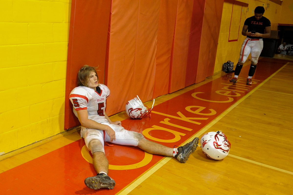 Winder-Barrow's Jeremy Ramsey sits against the wall in exhausting after winning a GHSA high school football game between Clarke Central and Winder-Barrow on Friday, Oct. 24, 2014, in Athens, Ga. (AJ Reynolds/Athens Banner-Herald)