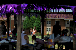 People gather under a gazebo during the back to school party at Bethel Midtown Village on Saturday, Aug. 8, 2015 in Athens, Ga. (AJ Reynolds/Staff, @ajreynoldsphoto)