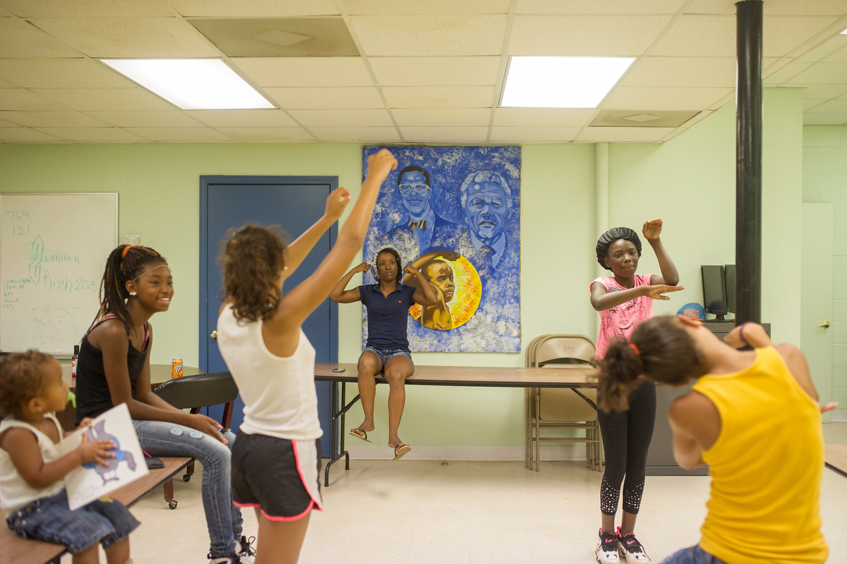 Shawn Burgess, center, gives instructions as girls practice a step dance routine at Bethel Midtown Village on Friday, July 24, 2015 in Athens, Ga. The girls practiced to perform their routine at the neighborhood's back to school bash. (AJ Reynolds/Staff, @ajreynoldsphoto)