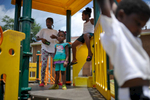 Ja'Niya Burgess, left, Da'Nasija Brown, second from right, and Daryl Nottingham play on a playground at Bethel Midtown Village on Wednesday, July 15, 2015 in Athens, Ga. (AJ Reynolds/Staff, @ajreynoldsphoto)
