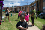 A young boy holds a cupcake during the back to school party at Bethel Midtown Village on Saturday, Aug. 8, 2015 in Athens, Ga. (AJ Reynolds/Staff, @ajreynoldsphoto)