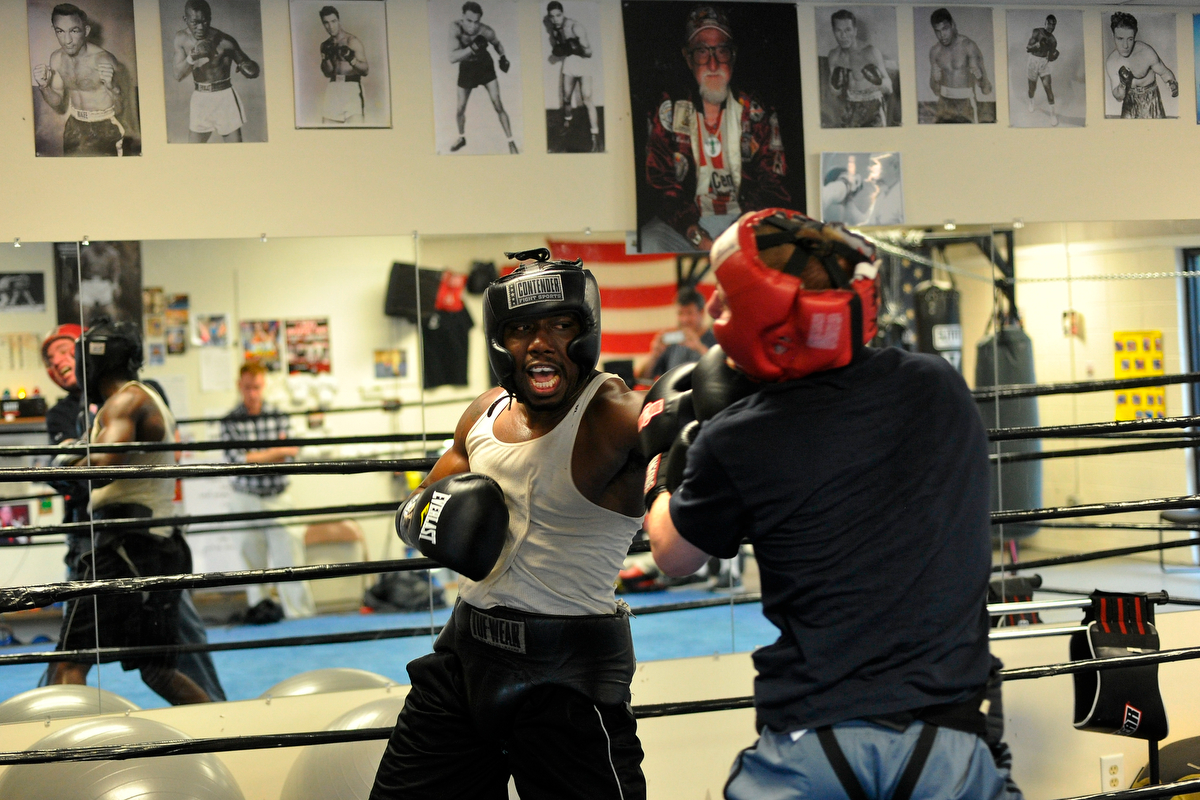 Tim Hall spars with Matt Klingerman, an amateur boxer and aspiring olympian from Rye, NY, at Keppner Boxing on Wednesday, August 20, 2014, in Athens, Ga. (AJ Reynolds/Staff, @ajreynoldsphoto)