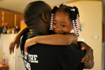 Tim Hall gets a hug from his daughter Katima Hall, five, after coming home from working hauling scrap metal on Wednesday, Aug. 27, 2014, in Athens, Ga. (AJ Reynolds/Staff, @ajreynoldsphoto)